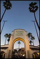 Entrance gate at dusk, Universal Studios. Universal City, Los Angeles, California, USA ( color)