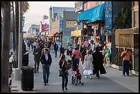 People stroll on Ocean Front Walk. Venice, Los Angeles, California, USA ( color)