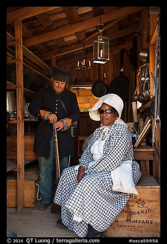 Elderly couple in period costume, Fort Tejon. California, USA (color)