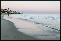 Beach at sunset with colors of sky reflected in wet sand. Laguna Beach, Orange County, California, USA ( color)