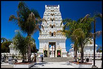 Family walks into Malibu Hindu Temple, Calabasas. Los Angeles, California, USA ( color)