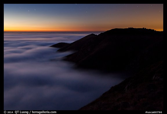 Hills emerging from sea of clouds at dusk, Garrapata State Park. Big Sur, California, USA (color)