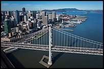 Aerial view of Bay Bridge, downtown, and piers. San Francisco, California, USA ( color)