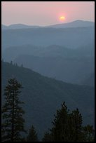 Sun setting over ridges, Stanislaus National Forest. California, USA ( color)