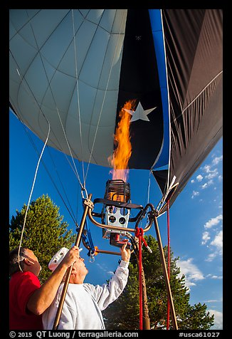 Pilot releases hot air into balloon, Tahoe National Forest. California, USA (color)