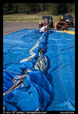 Hot air balloon being folded for transportation, Tahoe National Forest. California, USA (color)