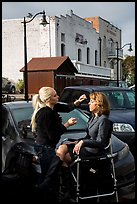 Makeup artist working on the street. Petaluma, California, USA ( color)