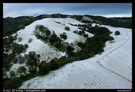 Aerial view of Evergreen Hills covered by hail. San Jose, California, USA (color)