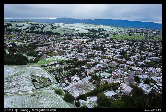 Aerial view of Meadowlands and hills covered by hail. San Jose, California, USA (color)