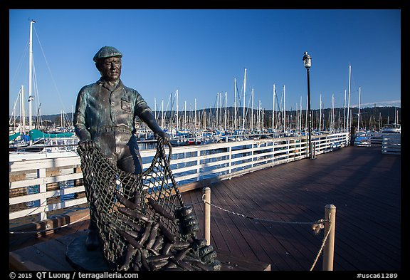 Statue of fisherman on wharf. Monterey, California, USA (color)