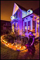 Woman in Halloween costume and decorated house. Petaluma, California, USA ( color)