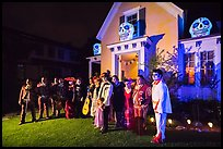 Family and guests pose in Halloween costumes. Petaluma, California, USA ( color)