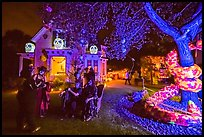 Revelers in Halloween costumes in decorated yard. Petaluma, California, USA ( color)