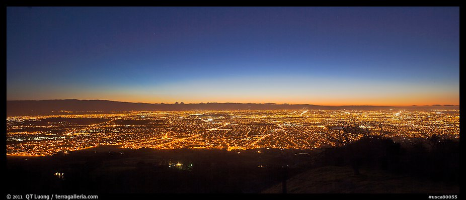 Lights of San Jose and Silicon Valley at sunset. San Jose, California, USA (color)