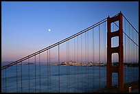 The city seen through the cables of the Golden Gate bridge, sunset. San Francisco, California, USA ( color)