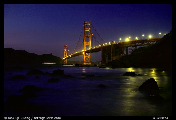 Golden Gate bridge and surf seen from E Baker Beach, night. San Francisco, California, USA (color)