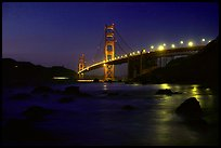 Golden Gate bridge and surf seen from E Baker Beach, night. San Francisco, California, USA