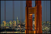The city seen through the cables and pilars of the Golden Gate bridge, night. San Francisco, California, USA ( color)