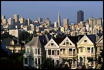 Victorians at Alamo Square and skyline, afternoon. San Francisco, California, USA