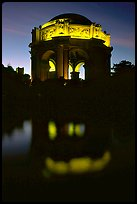 Rotunda of the Palace of Fine arts reflected in lagoon at  night. San Francisco, California, USA