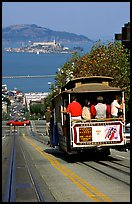Cable car on Hyde Street, with Alcatraz Island in the background. San Francisco, California, USA