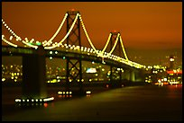 Bay Bridge seen from Treasure Island with defocused lights, sunset. San Francisco, California, USA