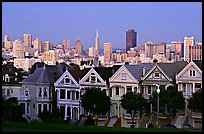 Victorians at Alamo Square and skyline, dusk. San Francisco, California, USA