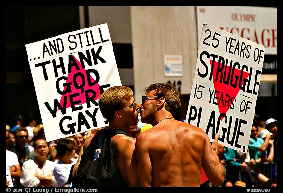 Gay couple with signs during the Gay Parade. San Francisco, California, USA (color)