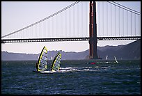 Windsurfers at Crissy Field, with the Golden Gate Bridge behind. San Francisco, California, USA