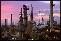 Chimneys of industrial Oil Refinery near Rodeo at dusk. SF Bay area, California, USA ( color)