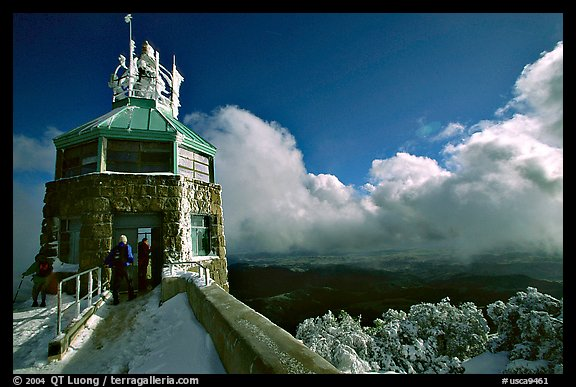 Hikers take refuge in the ice-clad summit tower during a cold winter day, Mt Diablo State Park. California, USA (color)