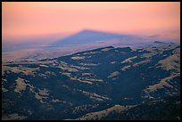Shadow of Mt Diable projects far into the Central Valley at sunset, Mt Diablo State Park. California, USA