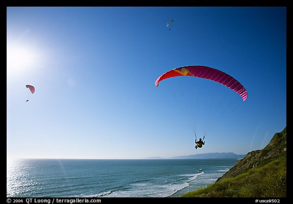 Paragliders soaring above the Ocean, the Dumps, Pacifica. San Mateo County, California, USA (color)