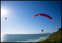 Paragliders soaring above the Ocean, the Dumps, Pacifica. San Mateo County, California, USA ( color)