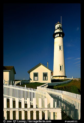 Fence and Pigeon Point Lighthouse, afternoon. San Mateo County, California, USA (color)