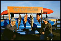 Fishermen with caught fish, Capitola. Capitola, California, USA (color)