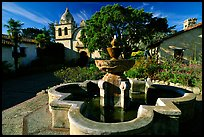 Fountain and chapel, Carmel Mission. Carmel-by-the-Sea, California, USA (color)