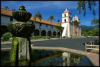 Fountain and Mission Santa Babara, mid-day. Santa Barbara, California, USA (color)