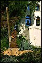 Cross, statue of father, belltower, Mission San Diego de Alcala. San Diego, California, USA (color)