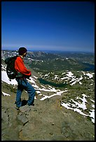 Hiker standing on top of Round Top Mountain. Mokelumne Wilderness, Eldorado National Forest, California, USA