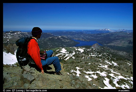 Hiker sitting  on top of Round Top Mountain. Mokelumne Wilderness, Eldorado National Forest, California, USA (color)