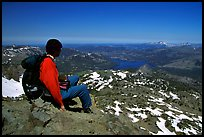 Hiker sitting  on top of Round Top Mountain. Mokelumne Wilderness, Eldorado National Forest, California, USA