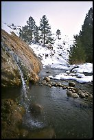 Water floweing over travertine, Buckeye Hot Springs in winter. California, USA