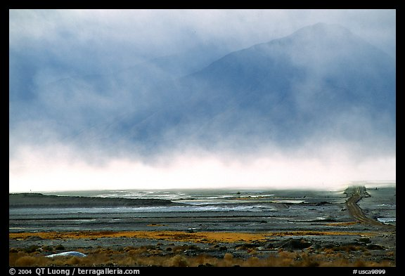 Mineral deposits of dry lake stirred up by a windstorm, Owens Valley. California, USA (color)