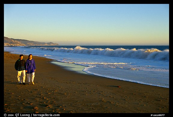 Couple strolling on the beach, late afternoon. Point Reyes National Seashore, California, USA