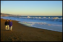 Couple strolling on the beach, late afternoon. Point Reyes National Seashore, California, USA ( color)