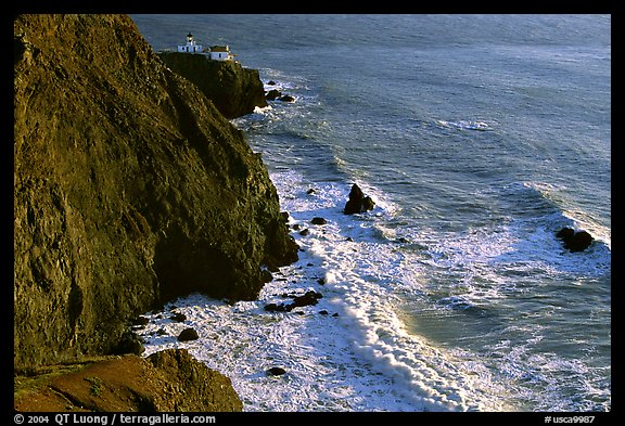 Cliffs, waves,  and Point Bonita Lighthouse, late afternoon. California, USA (color)