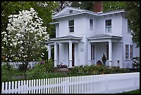 White picket fence and house, Essex. Connecticut, USA (color)