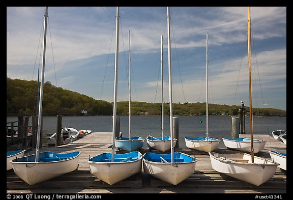Small sailboasts parked on deck and Mystic River. Mystic, Connecticut, USA (color)