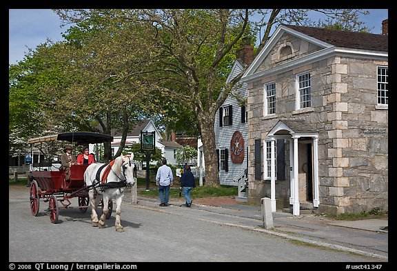 Horse carriage and bank building. Mystic, Connecticut, USA